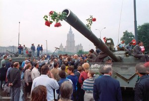 Russian citizens challenging the young and confused troops in the tanks by decorating these lethal weapons with flowers.